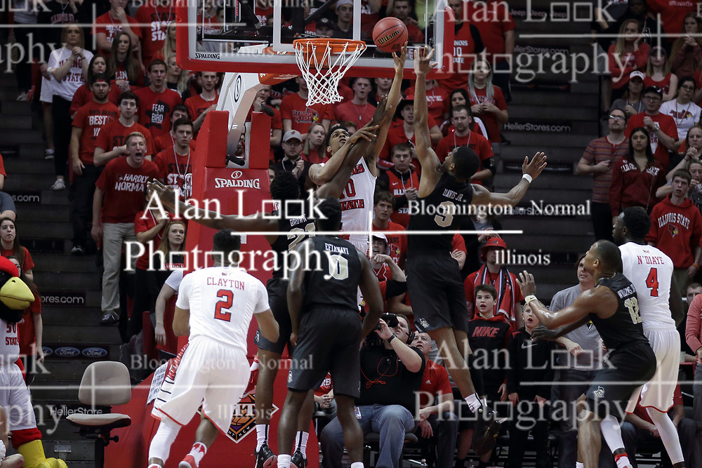 20 March 2017:  Phil Fayne(10) shoots a reverse to get past Chad Brown, Tank Efianayi, and A.J. Davis during a College NIT (National Invitational Tournament) 2nd round mens basketball game between the UCF (University of Central Florida) Knights and Illinois State Redbirds in  Redbird Arena, Normal IL