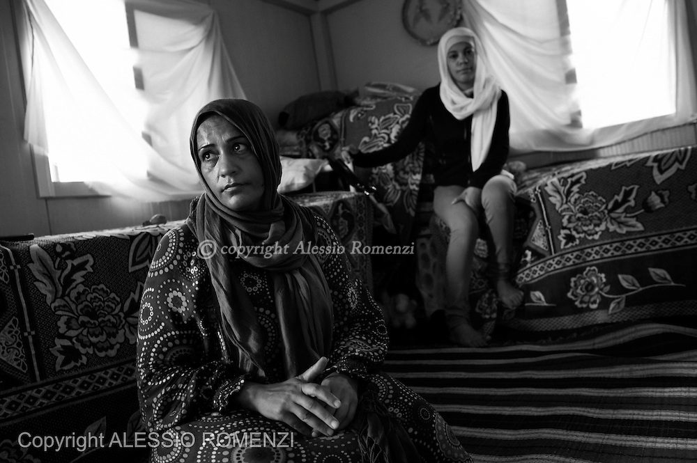 LEBANON: Saida.<br /> Amina and Batul are seen inside a prefab house at Albunian Camp in Saida,  where they are now living after they fled from Syria. ALESSIO ROMENZI