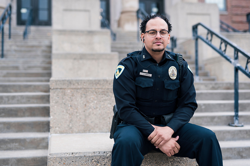 Madison Police Officer Justin Creech sits for a portrait at West High School in Madison, WI on Tuesday, April 30, 2019.