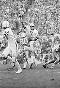 COLLEGE FOOTBALL: Stanford v Cal, Nov 20, 1976 at Memorial Stadium in Berkeley, California.  Guy Benjamin #7 attempts a pass.