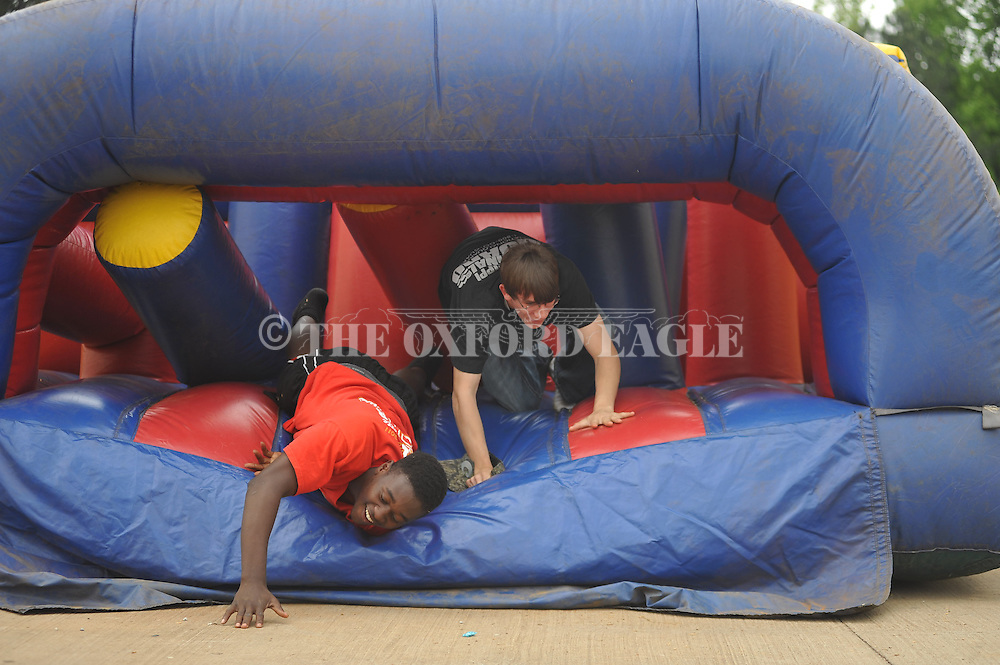 Joshua Barry (left) and Dakota Montgomery race during the Lafayette High senior picnic in Oxford, Miss. on Wednesday, May 1, 2013.