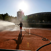 2017 French Open Tennis Tournament - A groundsman waters an outside clay court at the end of the day in preparation for the 2017 French Open Tennis Tournament at Roland Garros on May 26th, 2017 in Paris, France.  (Photo by Tim Clayton/Corbis via Getty Images)