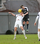 Dundee&rsquo;s Paul McGowan outjumps Dumbarton&rsquo;s Grant Gallagher - Dumbarton v Dundee, William Hill Scottish Cup fifth round at The Cheaper Insurance Direct Stadium <br /> <br />  - &copy; David Young - www.davidyoungphoto.co.uk - email: davidyoungphoto@gmail.com