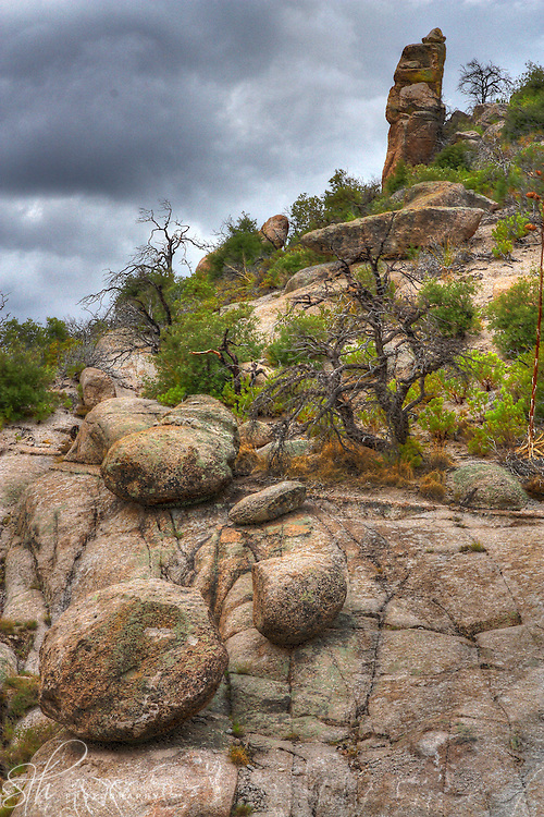 Boulders on a slope at the top of Mt. Lemmon, an approaching storm