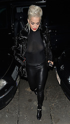 Singer Rita Ora wearing a black fur coat, see-through top, leather trousers and a pair of black chain ankle boots, arriving home after Charli XCX's gig at the Shepherd Bush Empire in London, UK. 25/03/2015<br />