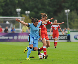 Manchester City Womens' Natasha Flint challenges for possession. - Photo mandatory by-line: Nizaam Jones- Mobile: 07583 387221 - 28/09/2014 - SPORT - Women's Football - Bristol - SGS Wise Campus - BAWFC v Man City Ladies - sport