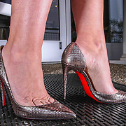 Susan Sotiropoulos pose for a photo while wearing Shoes by Christian Louboutin Saturday, May 19, 2018, at White House Black Market Street in Greenville.