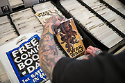 Jimmy Dowell of Morgan Hill looks at back issues of comic books during Free Comic Book Day at Black Cat Comics in Milpitas, California, on May 6, 2017. (Stan Olszewski/SOSKIphoto)