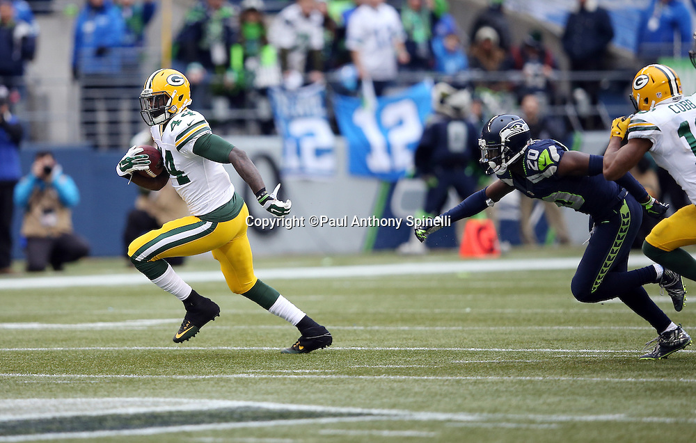 Green Bay Packers running back James Starks (44) runs for a fourth quarter gain of 32 yards to the Seattle Seahawks 43 yard line while chased by Seattle Seahawks cornerback Jeremy Lane (20) during the NFL week 20 NFC Championship football game against the Seattle Seahawks on Sunday, Jan. 18, 2015 in Seattle. The Seahawks won the game 28-22 in overtime. ©Paul Anthony Spinelli