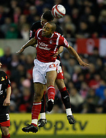 Photo: Steve Bond/Richard Lane Photography. Nottingham Forest v Doncaster Rovers. Coca Cola Championship. 28/11/2009. Dexter Blackstock (front) is an aerial duel with Jason Shackell