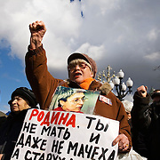 """A crowd pays tribute to Russian journalist Anna Politkovskaya, six months after she was murdered in Moscow. .The placard on the woman reads:""""Motherland -- You are not a mother and not even a stepmother. You are an old woman named Death."""".About 300 people gathered 7 March, 2007 on Pushkin Square to commemorate the six-month anniversary of Politkovskaya's death and to call on the authorities to bring her killer to justice..Known for her critical coverage of the war in Chechnya, she was shot to death in the elevator of her apartment building in Moscow, in a killing prosecutors believe could be connected to her investigative work..Politkovskaya was a tireless reporter who had written a critical book on Russian President Vladimir Putin and his campaign in Chechnya, documenting widespread abuse of civilians by government troops..Prosecutors have opend a murder investigation into her death, said Svetlana Petrenko, spokeswoman for the Moscow prosecutor's Office. Investigators suspect the killing was connected to the work of the 48-year-old journalist, Vyacheslav Raskinsky, Moscow's first deputy prosecutor said on state-run Rossiya television."""