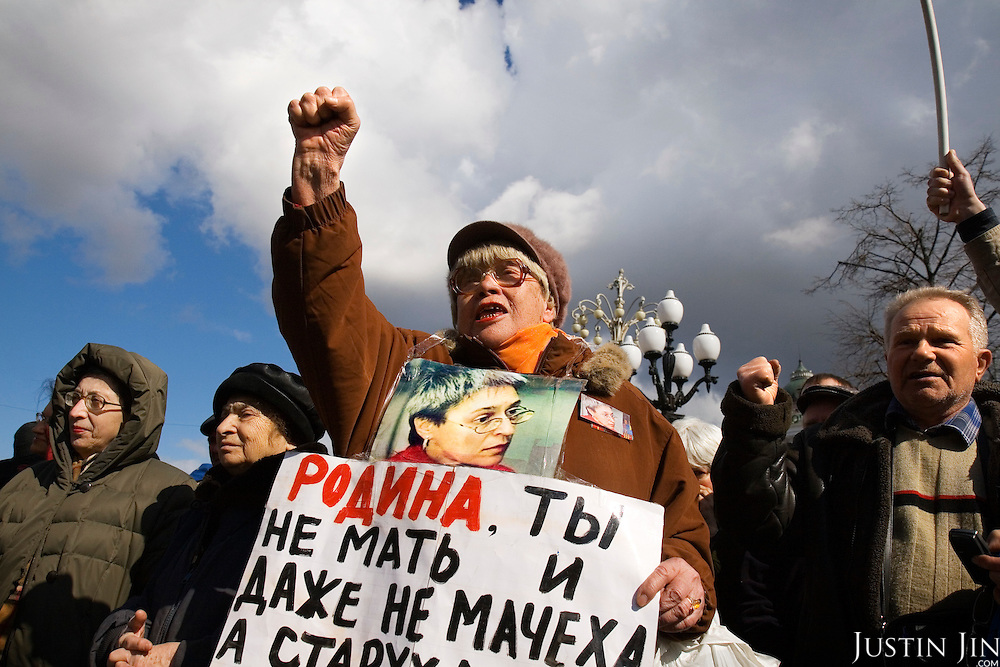 "A crowd pays tribute to Russian journalist Anna Politkovskaya, six months after she was murdered in Moscow. .The placard on the woman reads:""Motherland -- You are not a mother and not even a stepmother. You are an old woman named Death."".About 300 people gathered 7 March, 2007 on Pushkin Square to commemorate the six-month anniversary of Politkovskaya's death and to call on the authorities to bring her killer to justice..Known for her critical coverage of the war in Chechnya, she was shot to death in the elevator of her apartment building in Moscow, in a killing prosecutors believe could be connected to her investigative work..Politkovskaya was a tireless reporter who had written a critical book on Russian President Vladimir Putin and his campaign in Chechnya, documenting widespread abuse of civilians by government troops..Prosecutors have opend a murder investigation into her death, said Svetlana Petrenko, spokeswoman for the Moscow prosecutor's Office. Investigators suspect the killing was connected to the work of the 48-year-old journalist, Vyacheslav Raskinsky, Moscow's first deputy prosecutor said on state-run Rossiya television."