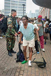 01 Sept, 2005. New Orleans, Louisiana.<br /> An elderly lady struggles to get in line to be led to busses evacuating her from New Orleans and the hellish conditions inside the Superdome.<br /> Photo©; Charlie Varley/varleypix.com