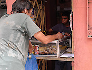 A tiny store in Habana Centro sells snacks and beverages from a streetside window. Stores like this are commonplace in Habana.