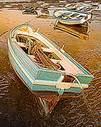 Art image of boats at low tide in Cadiz, Spain