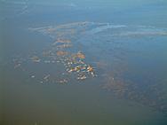 Luchtfoto van mosselbanken in de Waddenzee tussen Ameland en de Friese kust.<br /> Aerial picture of mussel beds (mussel banks) in the Dutch Wadden Sea.
