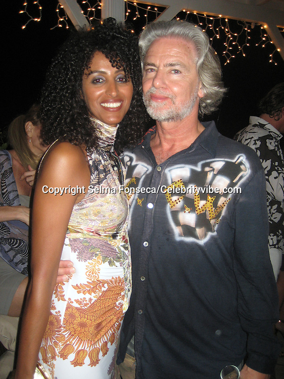 **EXCLUSIVE**.Hermann Buhlbecker, Lambertz Chocolate Ceo, with girlfriend.Russsell Simmons Party.Carl Gustaf Hotel.St. Barth, Caribbean.Friday, December 28, 2007 .Photo By Selma Fonseca/ Celebrityvibe.com.To license this image please call (212) 410 5354; or.Email: celebrityvibe@gmail.com ;.website: www.celebrityvibe.com