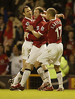 Photo: Aidan Ellis.<br /> Manchester United v Portsmouth. The FA Cup. 27/01/2007.<br /> United's Ryan Giggs (L) and Henrik Larsson celebrate with Wayne Rooney after the second goal