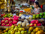 03 AUGUST 2017 - SUKAWATI, BALI, INDONESIA: A vegetable vender in the market in Sukawati. Bali's local markets are open on an every three day rotating schedule because venders travel from town to town. Before modern refrigeration and convenience stores became common place on Bali, markets were thriving community gatherings. Fewer people shop at markets now as more and more consumers go to convenience stores and more families have refrigerators.    PHOTO BY JACK KURTZ