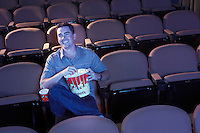 Man Watching Movie in Empty Theater