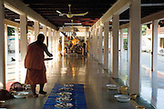 Soon after their return from their morning alms collection, the food is set out for breakfast in the main hall of the temple.