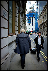 The London Mayor Boris Johnson walking past Bank on his way to Liverpool Street Station to visit Stamford Hill, London, Thursday April 5, 2012. Photo By Andrew Parsons/ i-Images..