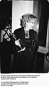 Jessica Lange with Oscar at the Oscar Night party hosted by Steve Tisch and Vanity Fair. Morton's. Los Angeles. March 1995. 95550/28<br />© Copyright Photograph by Dafydd Jones<br />66 Stockwell Park Rd. London SW9 0DA<br />Tel 0171 733 0108