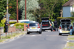 © Licensed to London News Pictures.  09/07/2013. OXFORD, UK. General view of the scene in Morton Avenue, Kidlington near Oxford where armed police are involved in a standoff with a man thought to be armed with a shotgun. The man is believed to have taken his twin children hostage. Photo credit: Cliff Hide/LNP