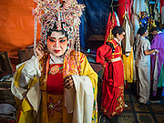 04 OCTOBER 2016 - BANGKOK, THAILAND: Chinese opera performers get into their costumes at the Vegetarian Festival at the Chit Sia Ma Chinese shrine in Bangkok. The Vegetarian Festival is celebrated throughout Thailand. It is the Thai version of the The Nine Emperor Gods Festival, a nine-day Taoist celebration beginning on the eve of 9th lunar month of the Chinese calendar. During a period of nine days, those who are participating in the festival dress all in white and abstain from eating meat, poultry, seafood, and dairy products. Vendors and proprietors of restaurants indicate that vegetarian food is for sale by putting a yellow flag out with Thai characters for meatless written on it in red.     PHOTO BY JACK KURTZ
