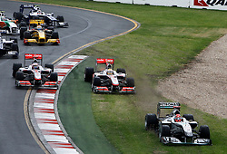MELBOURNE, AUSTRALIA - Saturday, March 28, 2009: Michael Schumacher (Mercedes GP), Lewis Hamilton (McLaren), and Jenson Button (McLaren) are forced off the track during a multi-car crash at the start of the Australian Grand Prix at the Melbourne Grand Prix Circuit. (Pic by Juergen Tap/Propaganda/Hoch Zwei)