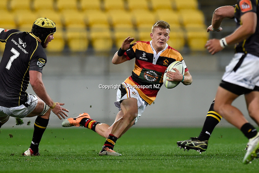 Waikato's Damian McKenzie runs with the ball during the ITM Wellington v Waikato rugby union match at the Westpac Stadium in Wellington on Saturday the 16th of August 2014.  Photo by Marty Melville/www.Photosport.co.nz