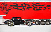 Image of a black hot rod racecar and a red trailer at Speed Week 2018 at the Bonneville Salt Flats, Utah, American Southwest