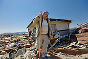 Katsunari Sasaki, 76, looks through the wreckage of his home, which was swept around 500 meters from its original site by the March 11 quake and tsunami in Rikuzentakata, Iwate Prefecture, Japan on  5 April 20011.  .Photographer: Robert Gilhooly