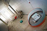"""Cabina telefonica distrutta e resti di ogni tipo in un corridoio interno dell'ex centro di permanenza temporanea """"Casa Regina Pacis"""" a San foca (LE) ormai in disuso. 21/02/2010 (PH Gabriele Spedicato)..I Centri di permanenza temporanea (CPT), ora denominati Centri di identificazione ed espulsione (CIE), sono strutture istituite in ottemperanza a quanto disposto all'articolo 12 della legge Turco-Napolitano (L. 40/1998) per ospitare gli stranieri """"sottoposti a provvedimenti di espulsione e o di respingimento con accompagnamento coattivo alla frontiera"""" nel caso in cui il provvedimento non sia immediatamenti eseguibile."""