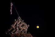 """A perigee moon rises behind the Iwo Jima Memorial in Arlington, Virginia shorty after sunset on Saturday night. The perigee moon appears so large because it is at the """"perigee"""" point in its orbit around earth, the closest point in the orbit's ellipse. """"The full Moon of March 19th occurs less than one hour away from perigee,"""" says Geoff Chester of the U.S. Naval Observatory  """"a near-perfect coincidence that happens only every 18 years or so."""""""