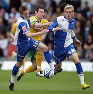 Bristol - Saturday May 1st, 2010: Jeff Hughes (L) and Daniel Jones (R) of Bristol Rovers in action against Stephen Elliott of Norwich City during the Coca Cola League One match at The Memorial Stadium, Bristol. (Pic by Mark Chapman/Focus Images)..