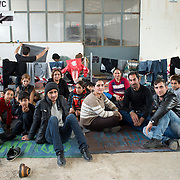 Greece with Doctors of the World (Medecins du monde). Chios Island, one of the places where refugees from Turkey land en route to Northern Europe. Tampakika camp in an old factory only used now when there are lots of arrivals. A Yazidi family wait.