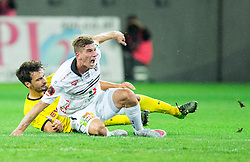Tadej Trdina of WAC faulted by Mats Hummels of Borussia Dortmund during football match between WAC Wolfsberg (AUT) and  Borussia Dortmund (GER) in First leg of Third qualifying round of UEFA Europa League 2015/16, on July 30, 2015 in Wörthersee Stadion, Klagenfurt, Austria. Photo by Vid Ponikvar / Sportida