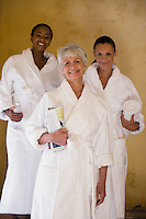 Portrait of three women in bathrobes