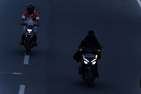 MEDAN, Indonesia, March 23, 2020: Motorists seen wearing masks while others do not at Sisingamangaraja street in Medan, Indonesia on March 23, 2020. As the update data of Worldometer about the Covid-19 pandemic has been killing 15,333 people from 351,067 cases in the world this day.