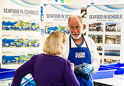 Pictured: Marine Scientist John Dunn was on hand to explain the different species that can be found in costal waters<br /> <br /> The Seafood in Schools project, which aims to teach children about Scottish seafood, visited Craigroyston Community High School today where 260 children took part in workshops with the opportunity to view and handle fresh and live species, including crab and lobster.<br /> Ger Harley | EEm 7 June 2016