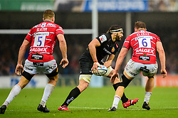 Don Armand of Exeter Chiefs, is marked by Ed Slater of Gloucester Rugby and Freddie Clarke of Gloucester Rugby - Mandatory by-line: Ryan Hiscott/JMP - 24/11/2018 - RUGBY - Sandy Park Stadium - Exeter, England - Exeter Chiefs v Gloucester Rugby - Gallagher Premiership Rugby