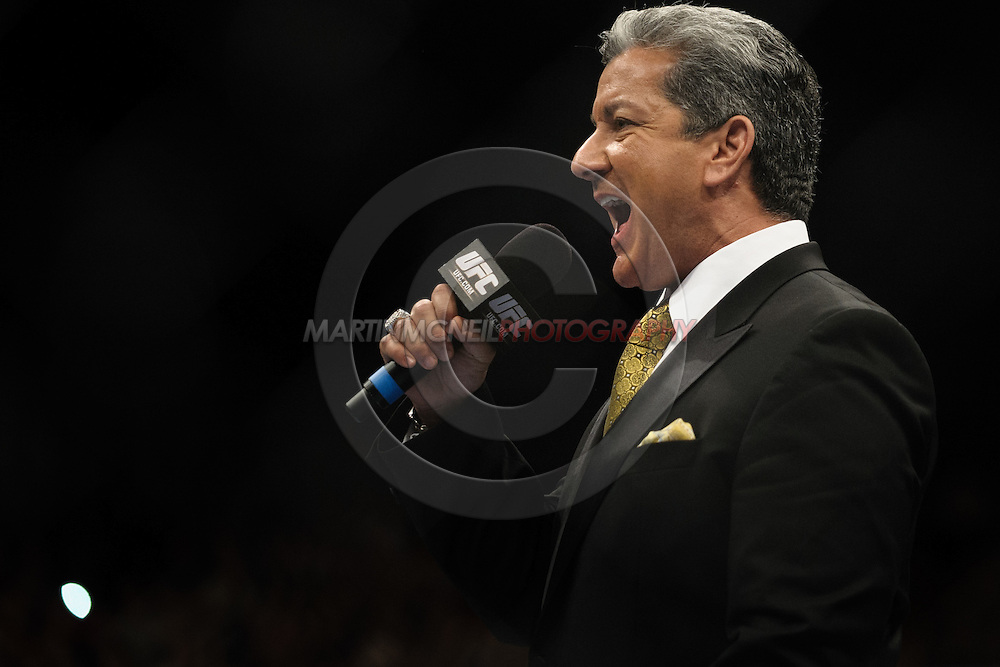 "BIRMINGHAM, ENGLAND, NOVEMBER 5, 2012: Bruce Buffer announces the start of the live television broadcast during ""UFC 138: Munoz vs. Leben"" inside the National Indoor Arena in Birmingham, United Kingdom"