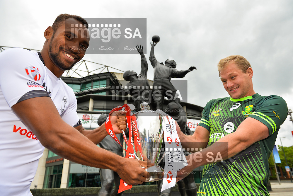 LONDON, ENGLAND - MAY 18: Osea Kolinisau (Fiji) and Philip Snyman (South Africa) wrestle over the championship trophy during the HSBC London Sevens Captains Photocall session at Twickenham Stadium on May 18, 2016 in London, England. (Photo by Roger Sedres/Gallo Images)