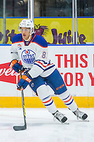 PENTICTON, CANADA - SEPTEMBER 16: Caleb Jones #81 of Edmonton Oilers skates with the puck against the Vancouver Canuckson September 16, 2016 at the South Okanagan Event Centre in Penticton, British Columbia, Canada.  (Photo by Marissa Baecker/Shoot the Breeze)  *** Local Caption *** Caleb Jones;