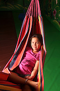 Young girl of ten lying in a hammock