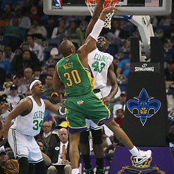 Feb 10, 2010; New Orleans, LA, USA; New Orleans Hornets forward David West (30) shoots over Boston Celtics center Kendrick Perkins (43) during the first quarter at the New Orleans Arena. Mandatory Credit: Derick E. Hingle-US PRESSWIRE
