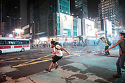 HONG KONG: Sunday 20 October 2019 A protester throws rocks at a police vehicle during clashes in Honk Kong on Sunday. Hundreds of thousands of protesters marched through the city's streets in defiance of the march being denied permission to take place as demonstrations roll into a 14th week. <br /> Rick Findler / Story Picture Agency