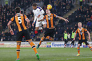 Newcastle United forward Dwight Gayle (9) and Hull City defender Michael Dawson (21) challenges for a header  during the EFL Quarter Final Cup match between Hull City and Newcastle United at the KCOM Stadium, Kingston upon Hull, England on 29 November 2016. Photo by Simon Davies.