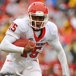 Sep 26, 2009; College Park, MD, USA; Rutgers quarterback Jabu Lovelace (15) runs for a first down during the first half of Rutgers' 34-13 victory over Maryland in NCAA college football at Byrd Stadium.